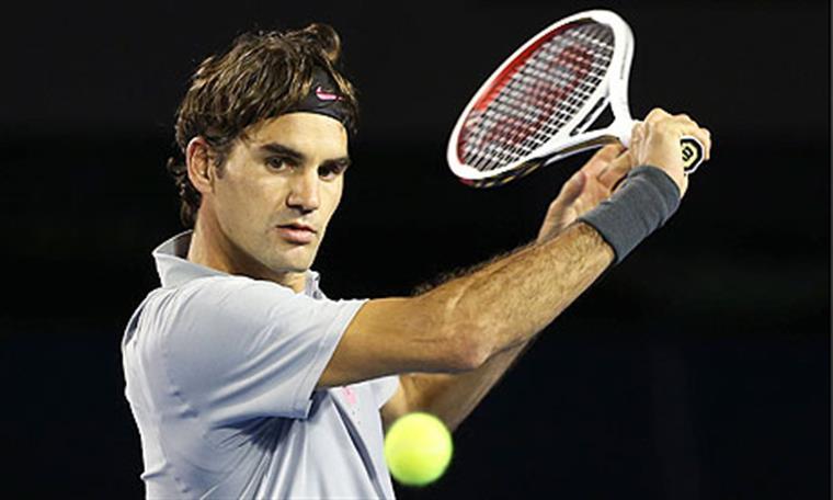 Federer olha para a bola e cá vai disto ò Wawrinka